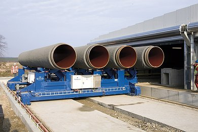 Concrete coated pipe joints leaving EUPEC concrete weight coating plant in Mukran, Germany
